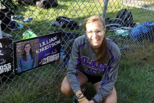 Lilly with her Senior Cross Country Sign